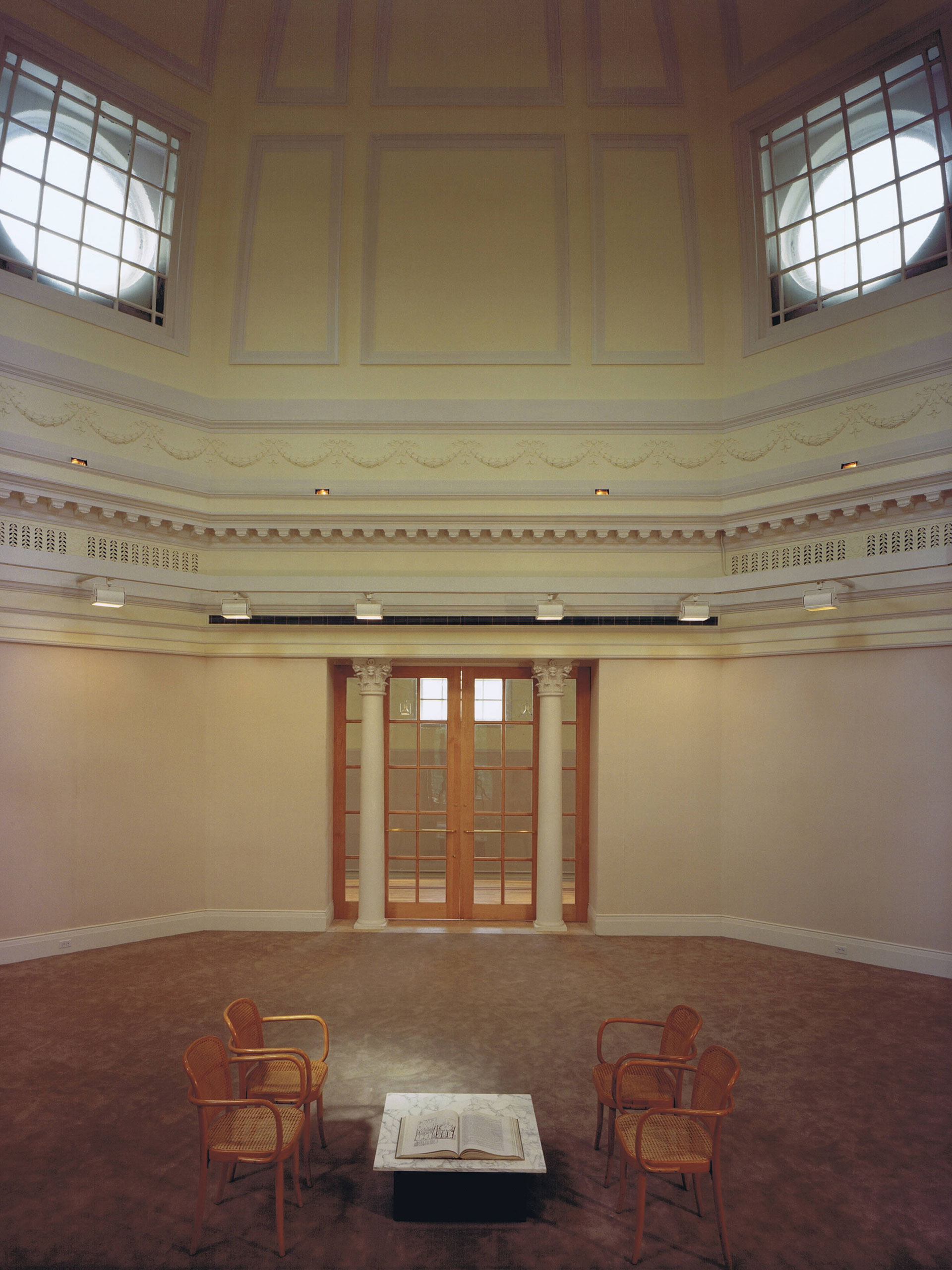 After the renovation, the small entrances were sealed, and larger entrances were added to the east and west sides. This moved the entrances away from classroom entrances to reduce distractions to other students. Additionally, the dome was opened up, allowing light from four large windows to illuminate the rotunda.