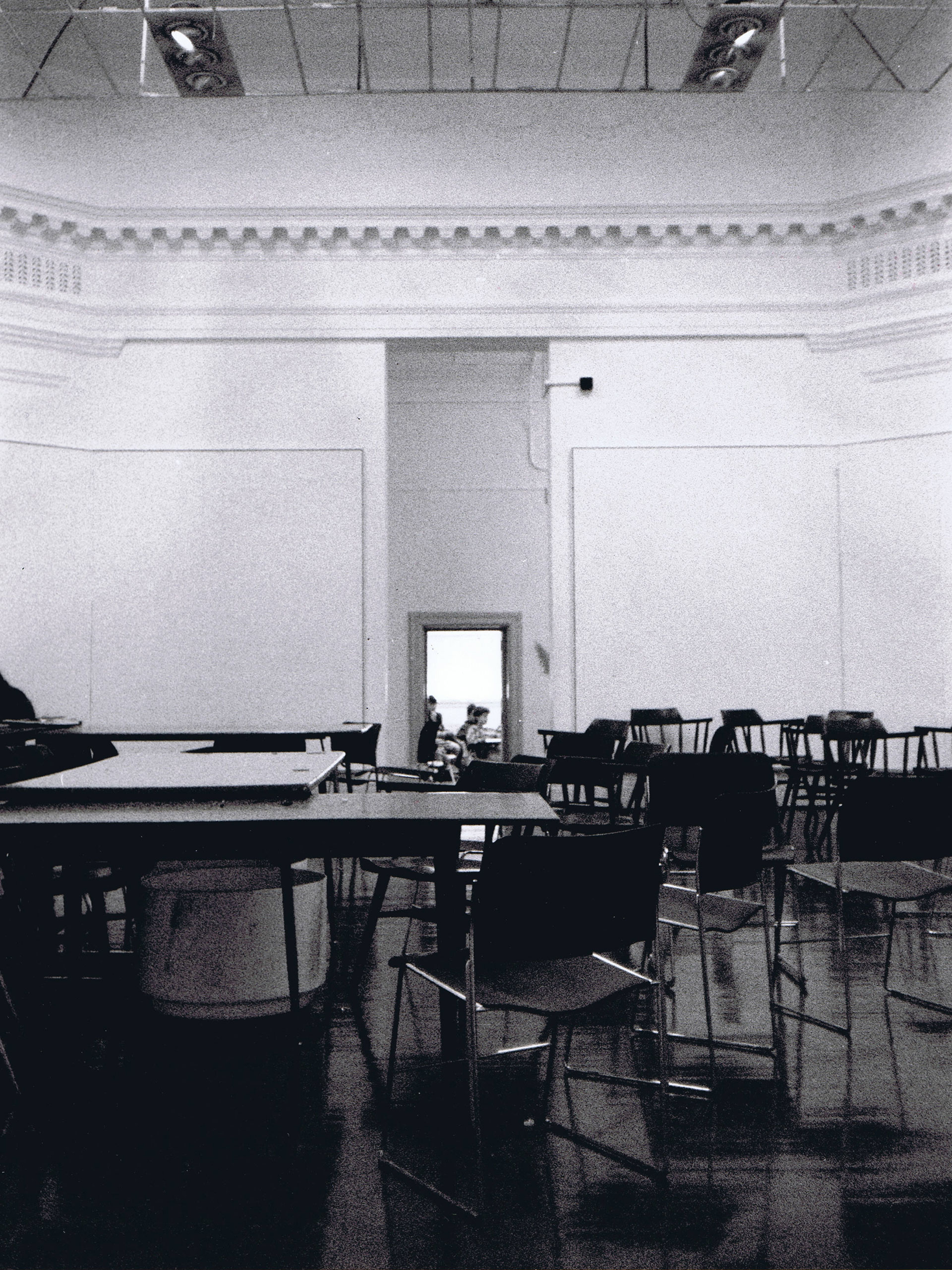Before the renovation, the Brooks Hall rotunda had small entrances on the north and south sides. Additionally, a dropped ceiling obscured the dome from within the rotunda.