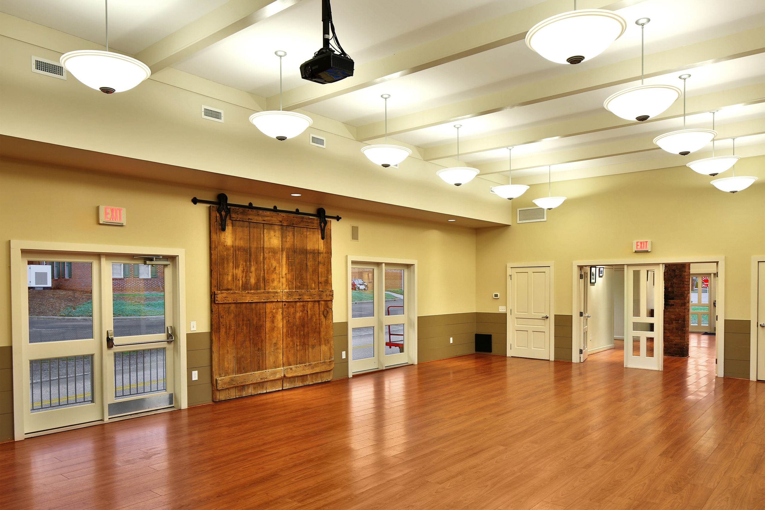 The Landrum Railroad Depot community room with the original freight doors on display.