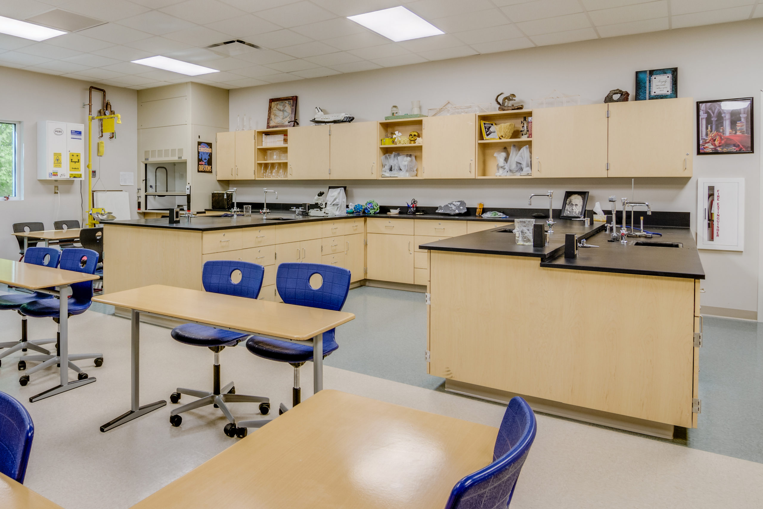 A photograph of a science lab and classroom in the Polk County Early College showing a mix of laboratory spaces in the rear of the classroom as well as desks in the front.