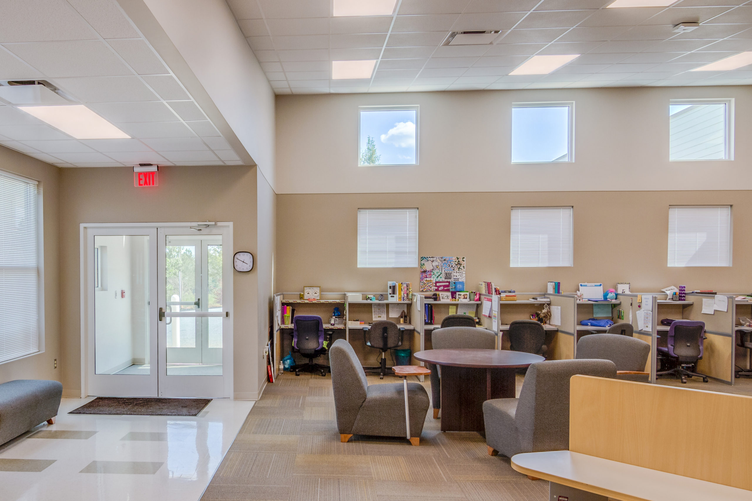 An interior view of the Polk County Early College showing student work areas and the main entrance.