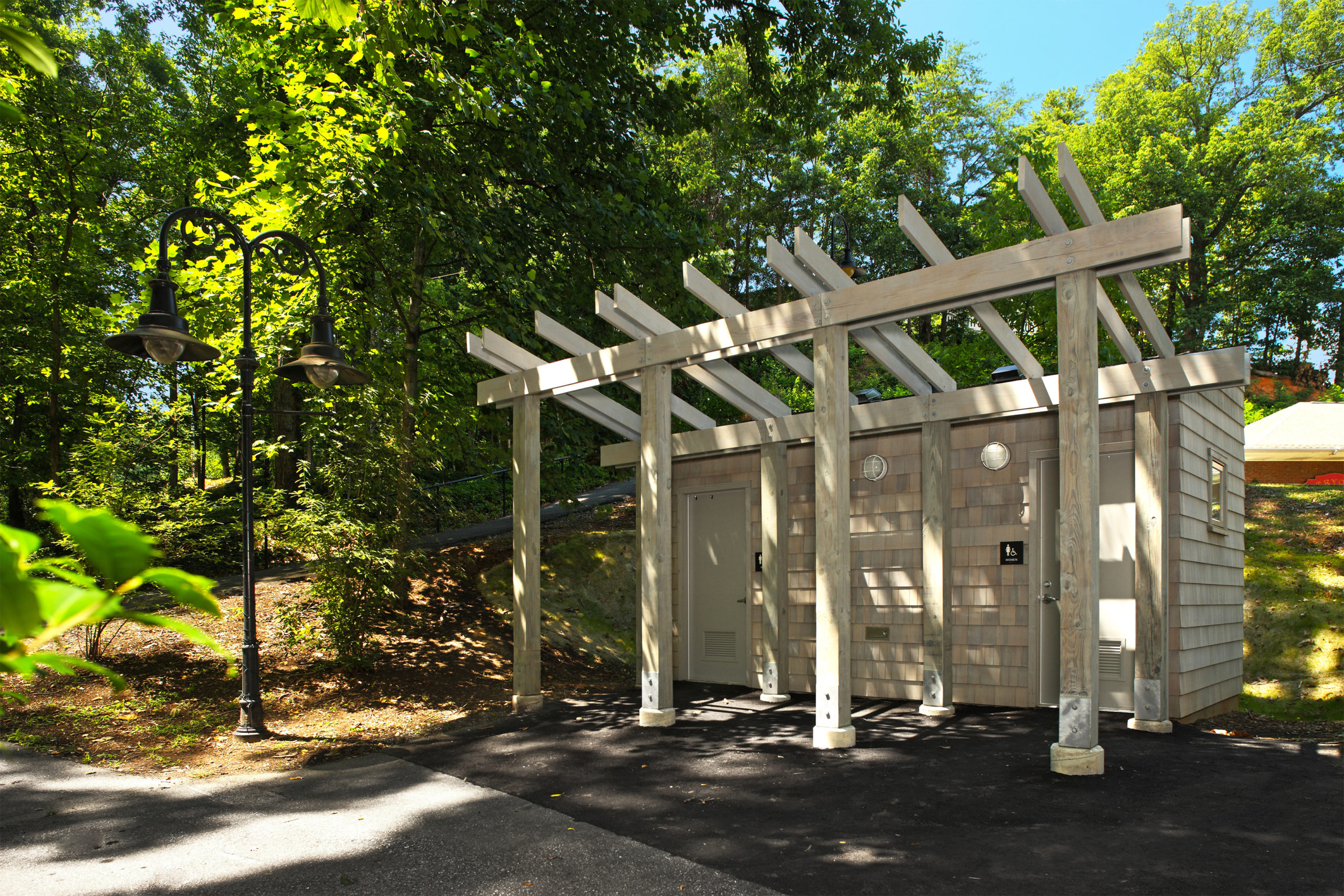 Entrance to the structure with pergola detail similar to existing park structures.