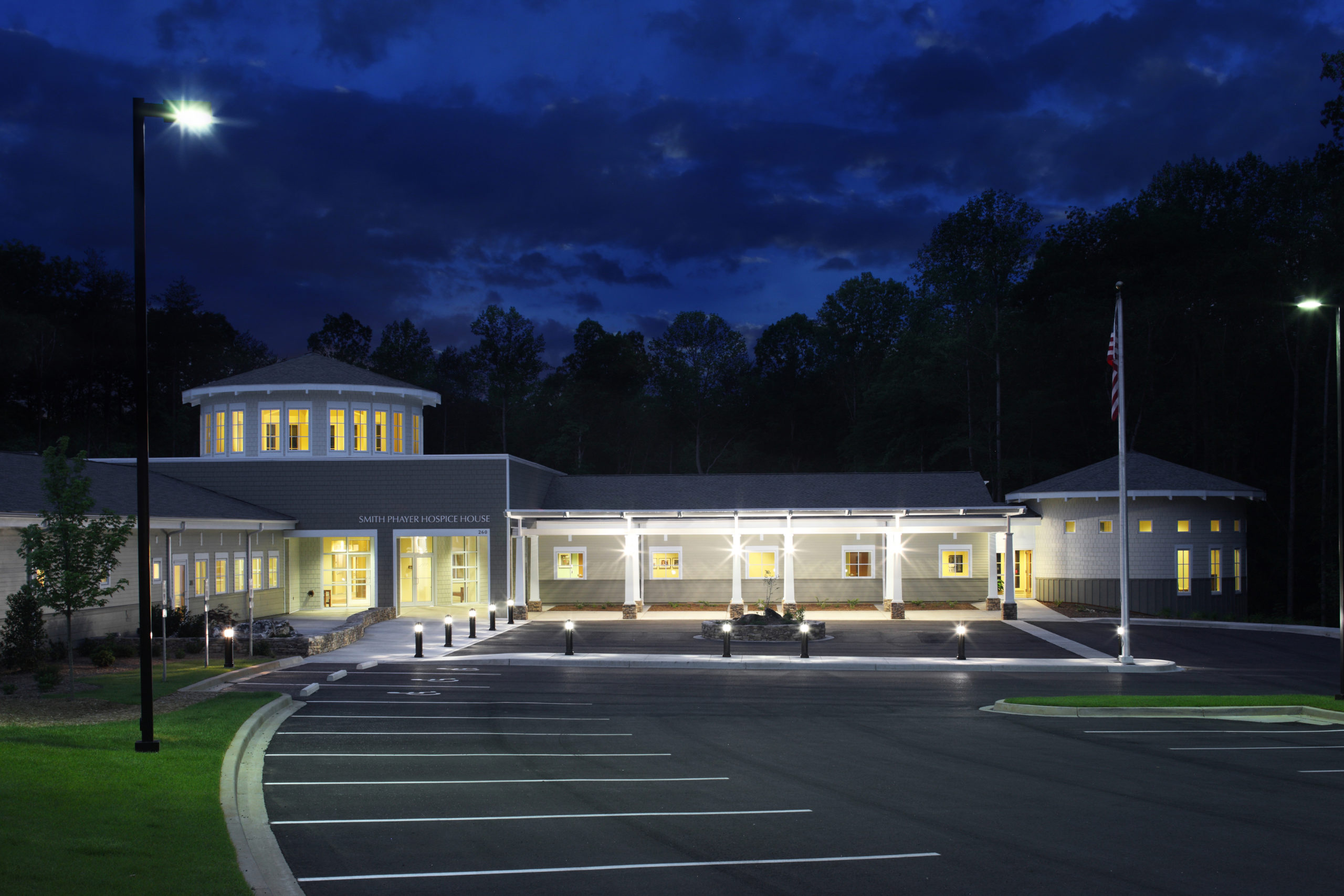 A photograph of the facility at night.
