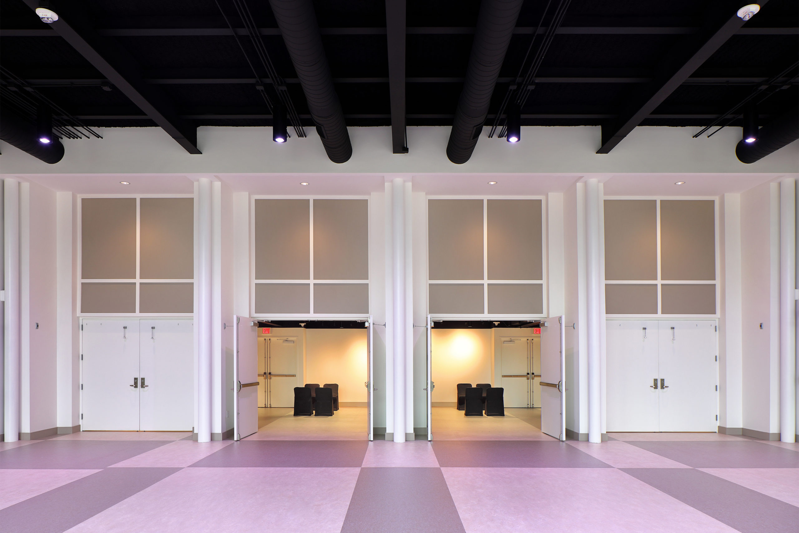 View to gallery from multipurpose space illustrating combined use of the two spaces.